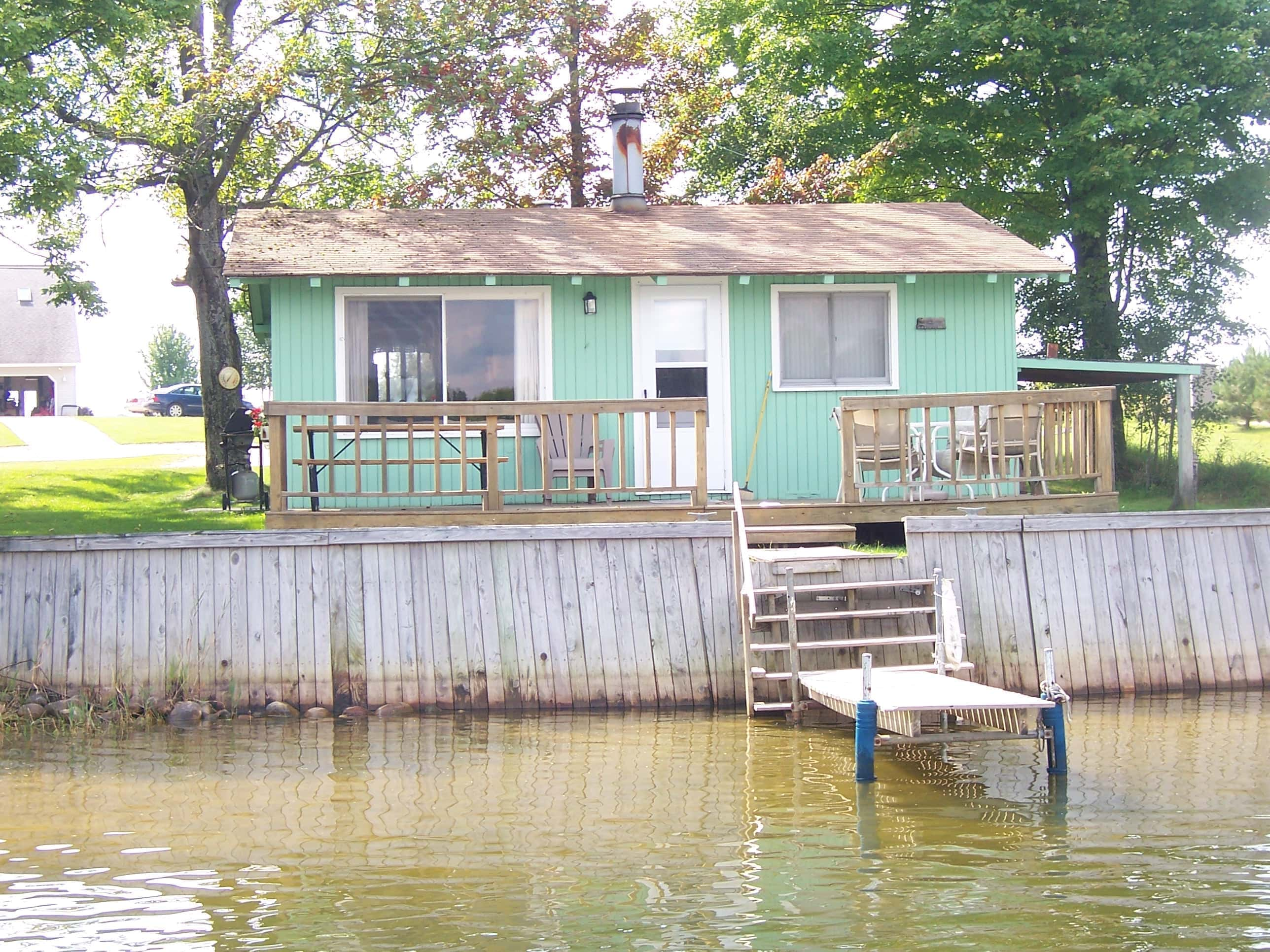 of for vacation with lake seasons michigan resort our in heart cottages right mi rent pine all the on wellston feet com to national manistee pinelakecabins over cabin sports beautiful cabins beach rental welcome sandy