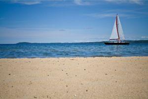 sailboat off the beach