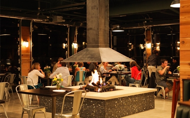 Barrel Back Restaurant's dining room features a sleek, metal-hooded gas fireplace.