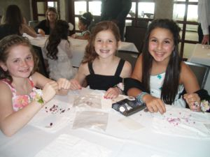 Craft project also entertains the young ladies.