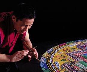 A monk creating a sand mandala