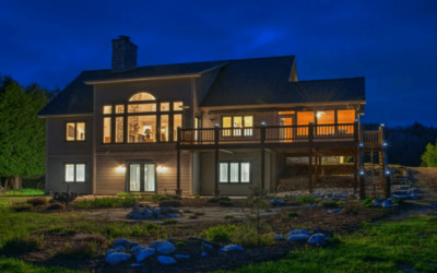 Bellaire Real Estate: Forest Retreat on Chain of Lakes
