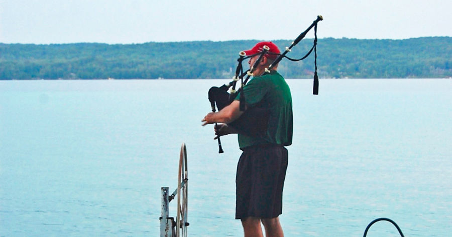 Piping on a friend's dock on Torch Lake.