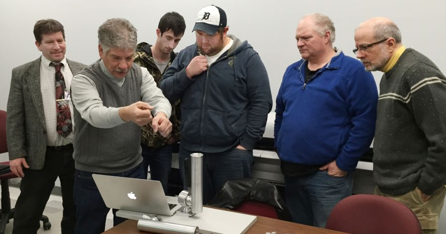 baker college students in cadillac helping inventor. Cars Review. Best American Auto & Cars Review