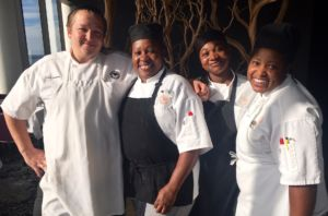 Larry Steffes, Executive Chef of Grand Traverse Resort's Aerie Restaurant with Jamaican chefs: Rose Henry, Kimberly Peddie and Lisa Lawrence