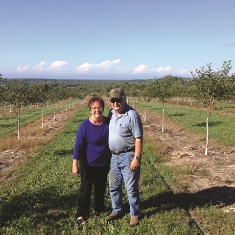 Mike and Janet McManus stand on the land they promised Karl Kiessel that they would never develop. The permanent protection of 141 acres ensures that their promise to Karl will always be kept.