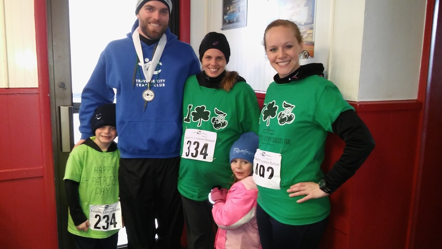 From left: Eric, Chris, Jessica, and Ally Stark with Rebecca Noffke at the finish of the March 2017 Leapin' Leprechaun Race.
