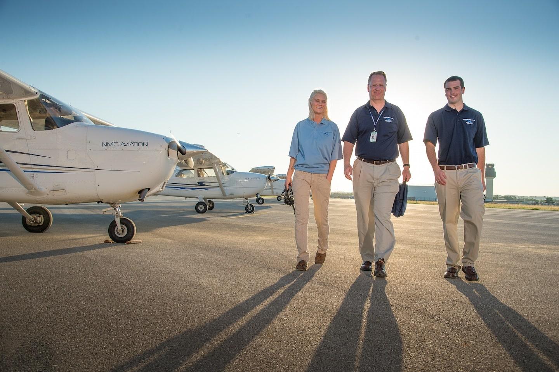 Al Laursen (center), with students, NMC Aviation program