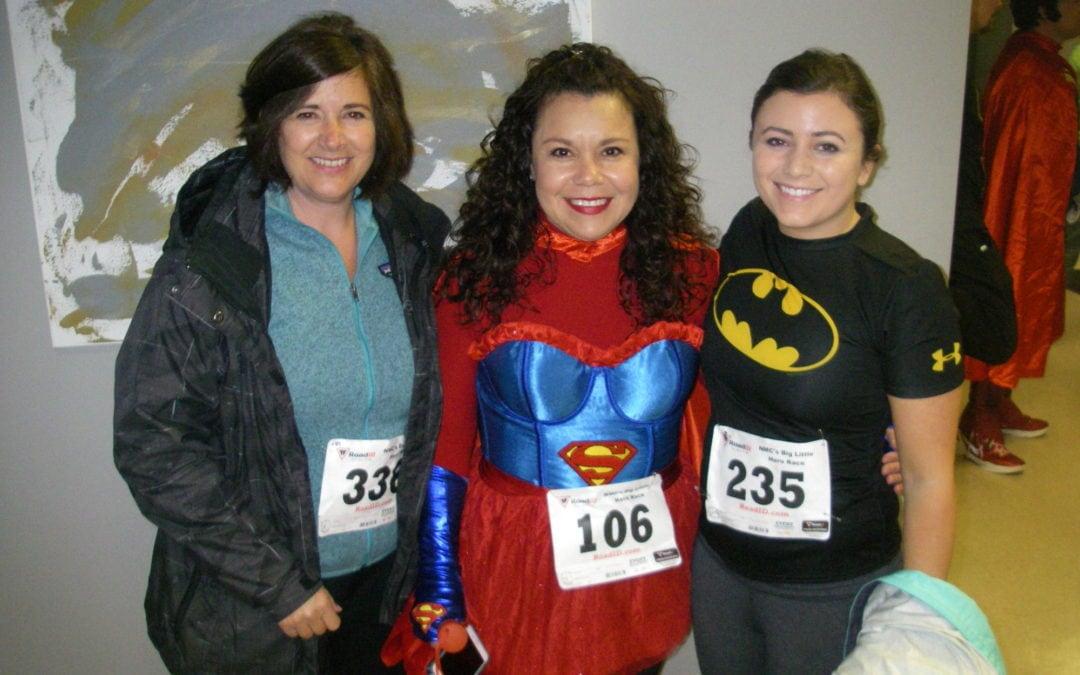 Runners dress like superheros for the Big Little Hero Race.