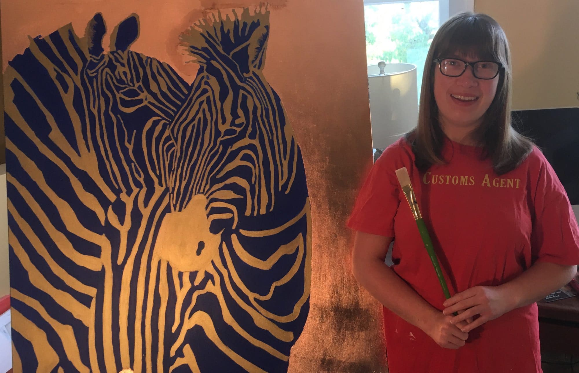Audrey Summers Smith working on her Zebras painting, for ArtPrize Nine
