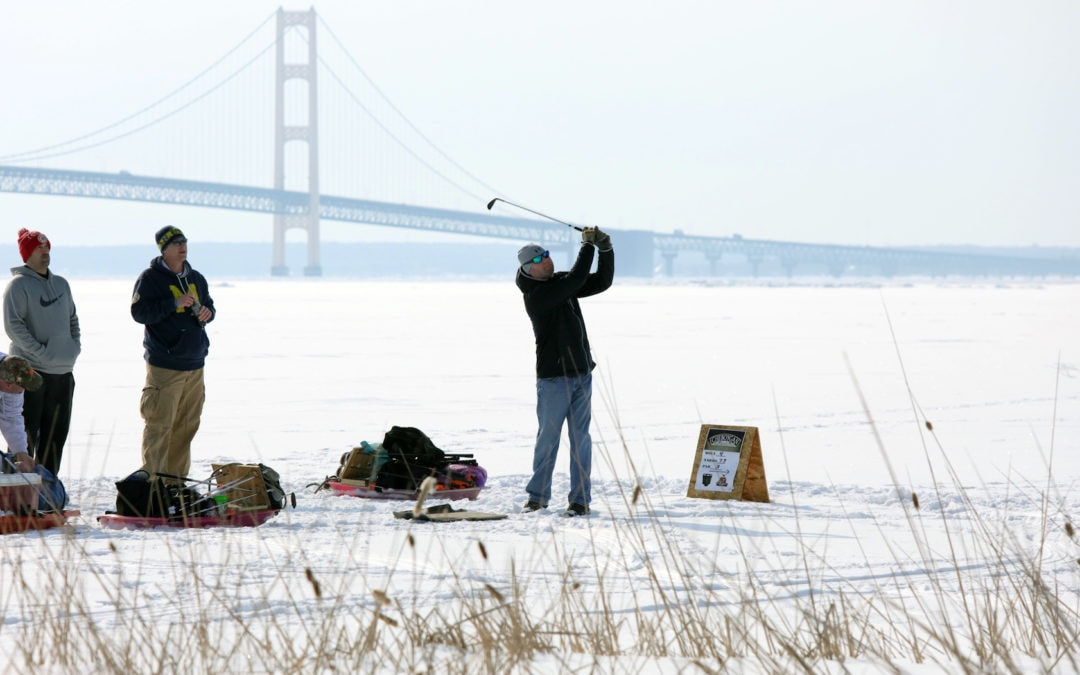 Play 9 Holes of Golf on a Frozen Great Lake with a View of the Mackinac Bridge