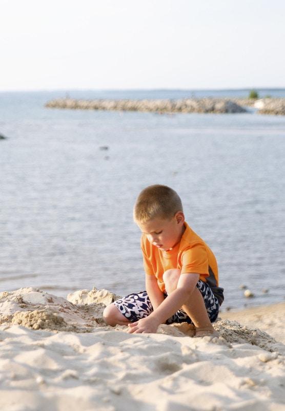 sleeping bear dunes, boy on beach, playing in sand, kid, kids