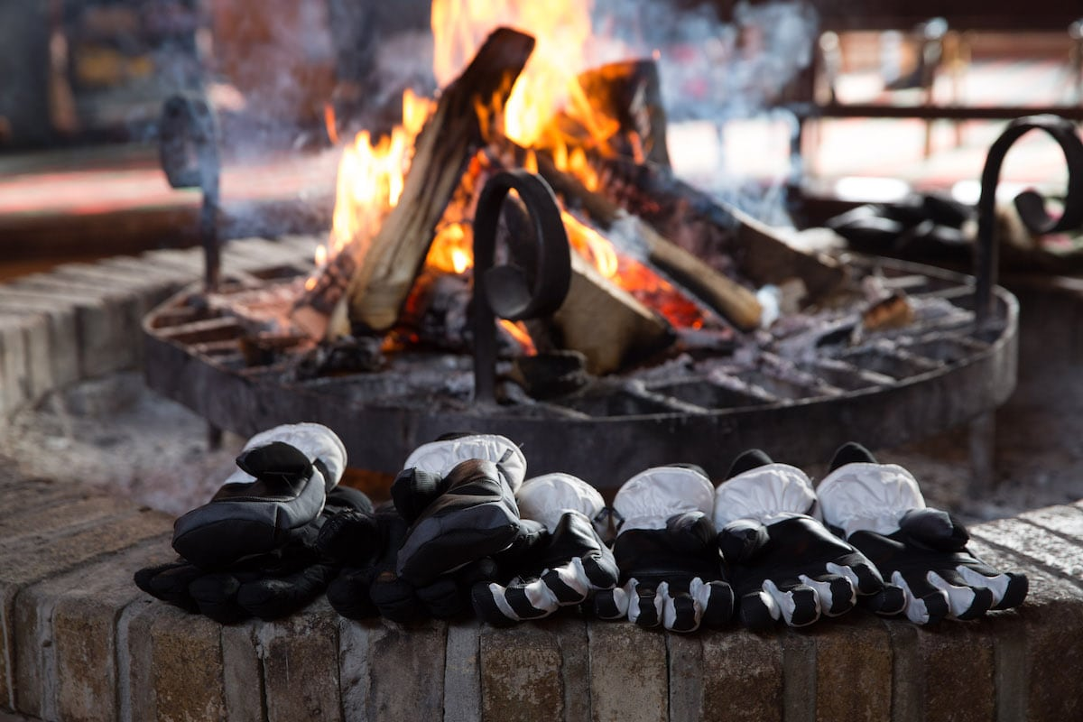 gloves drying by a fire outdoors