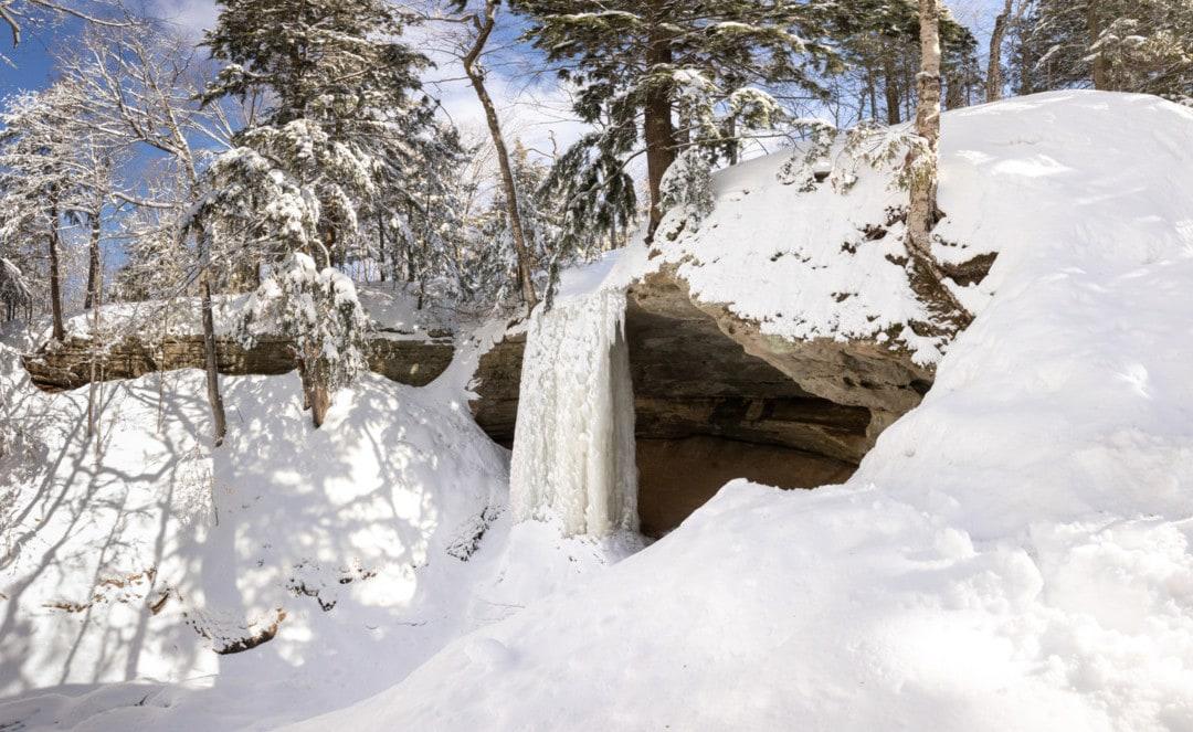 Hike to Northern Michigan's Breathtaking Frozen Waterfalls