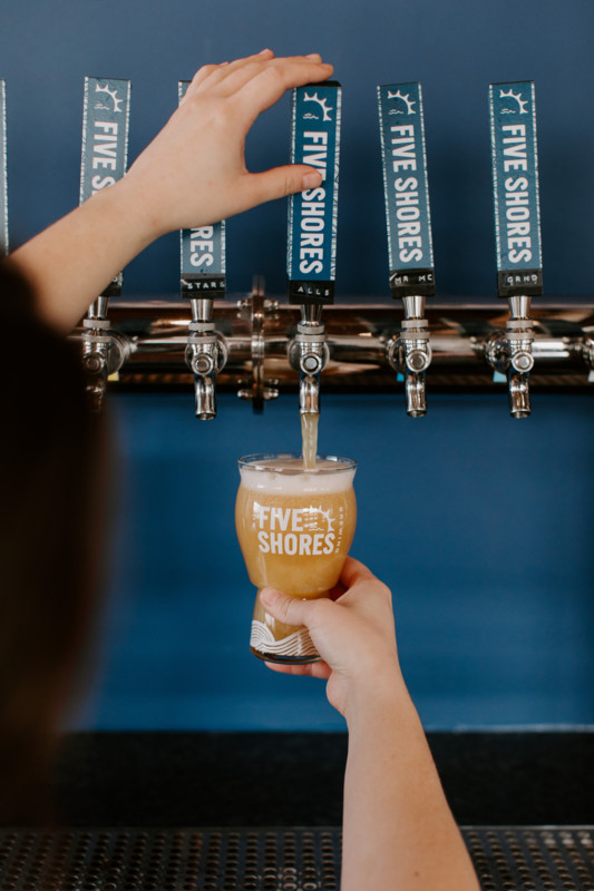 Pouring a beer at Five Shores Brewery in Benzie County