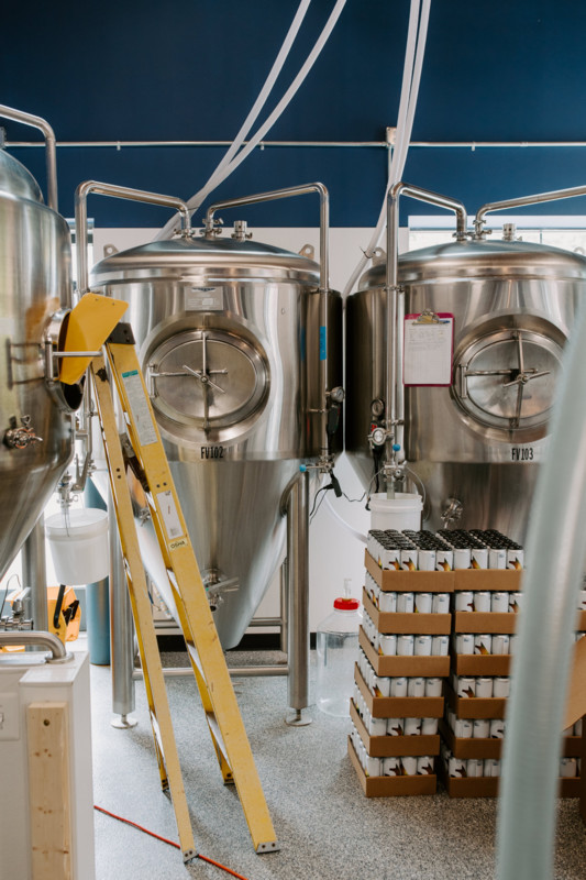 The large, metal brewing tanks at Five Shores Brewing in Benzie County.