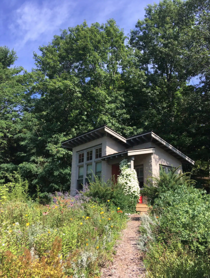 Tiny House Airbnb surrounded by gorgeous plants.