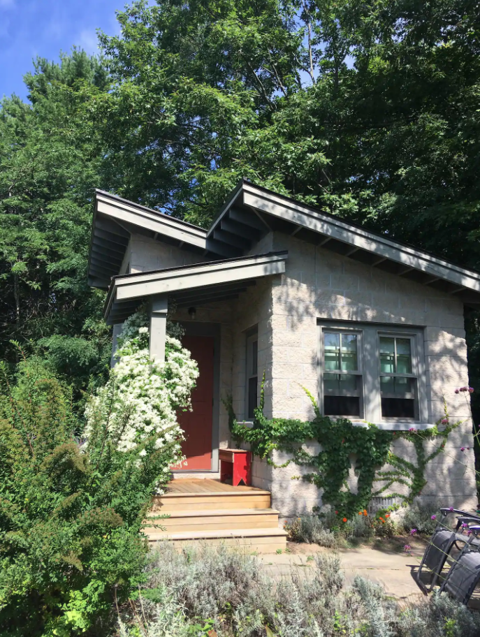 Airbnb in Michigan with a front porch.