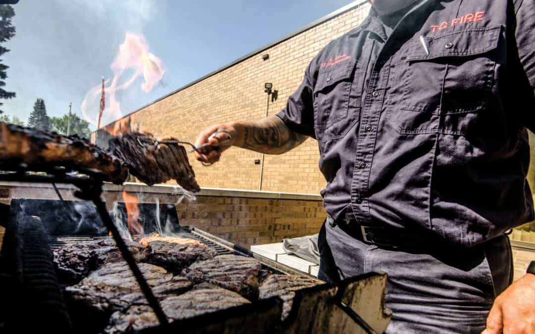 Firefighter grilling in Traverse City.