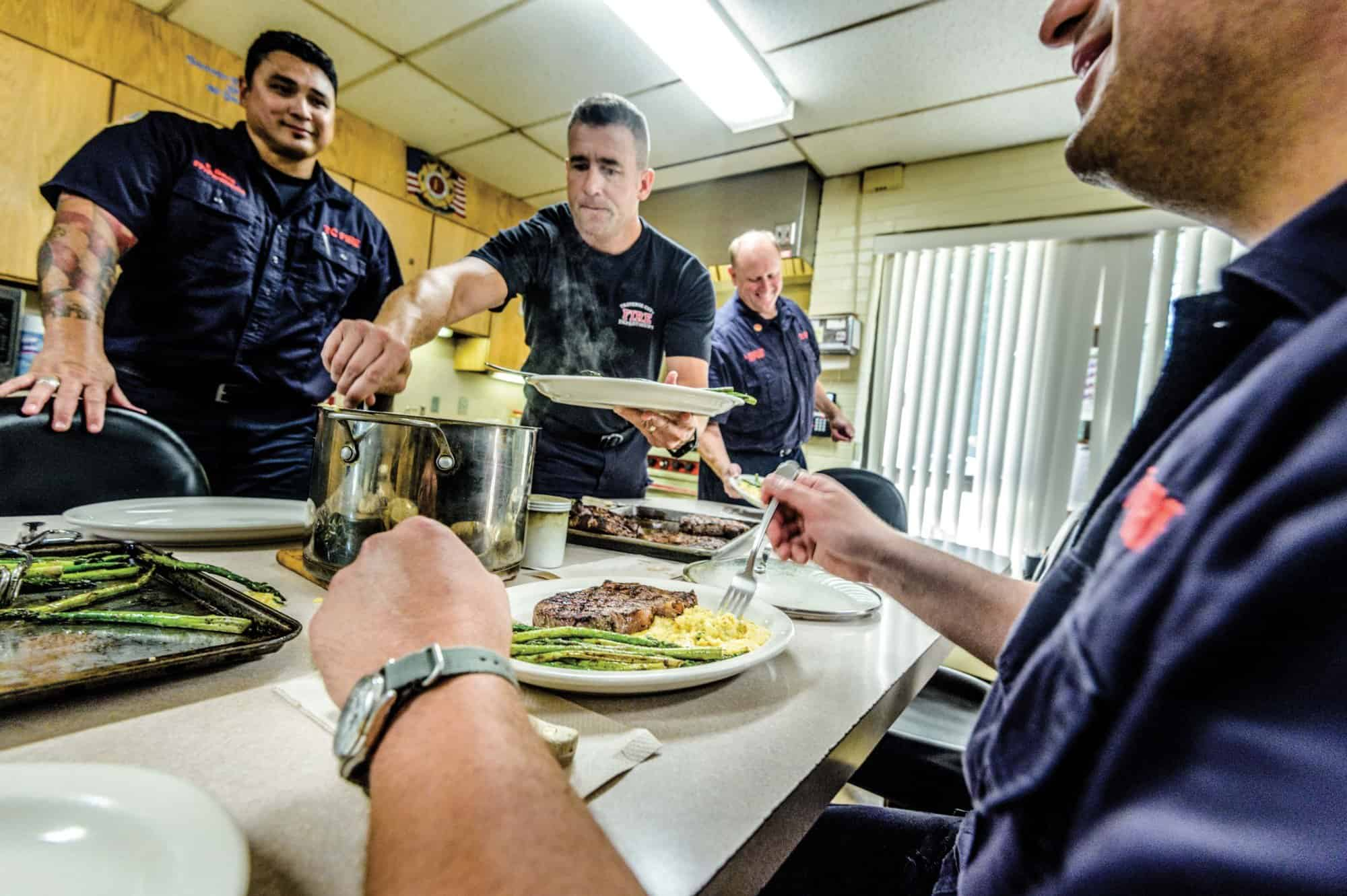 Firefighters in Traverse City enjoying a grilled BBQ meal.