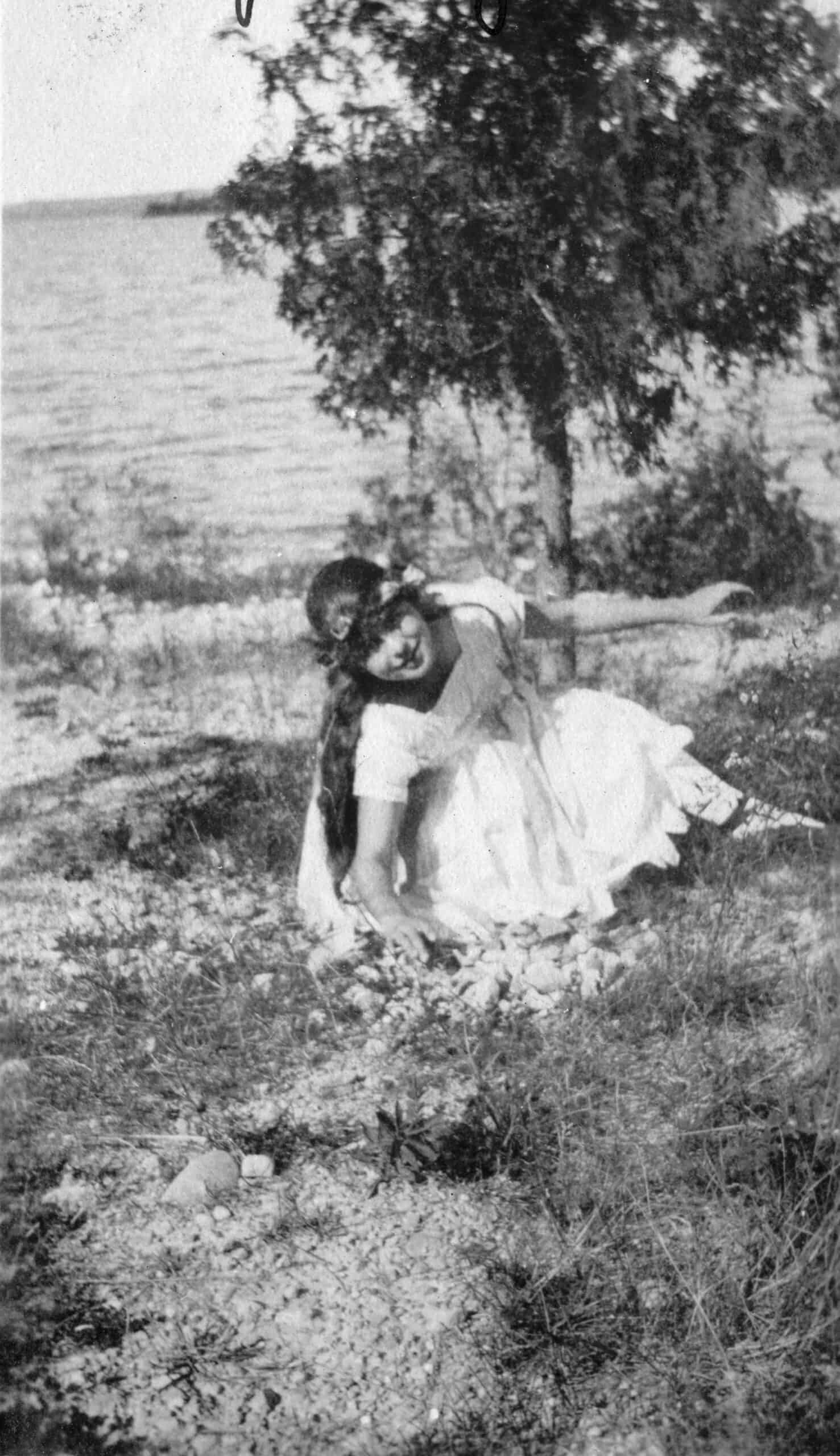 Mary Meany's grandmother plays near their cottage in 1918.