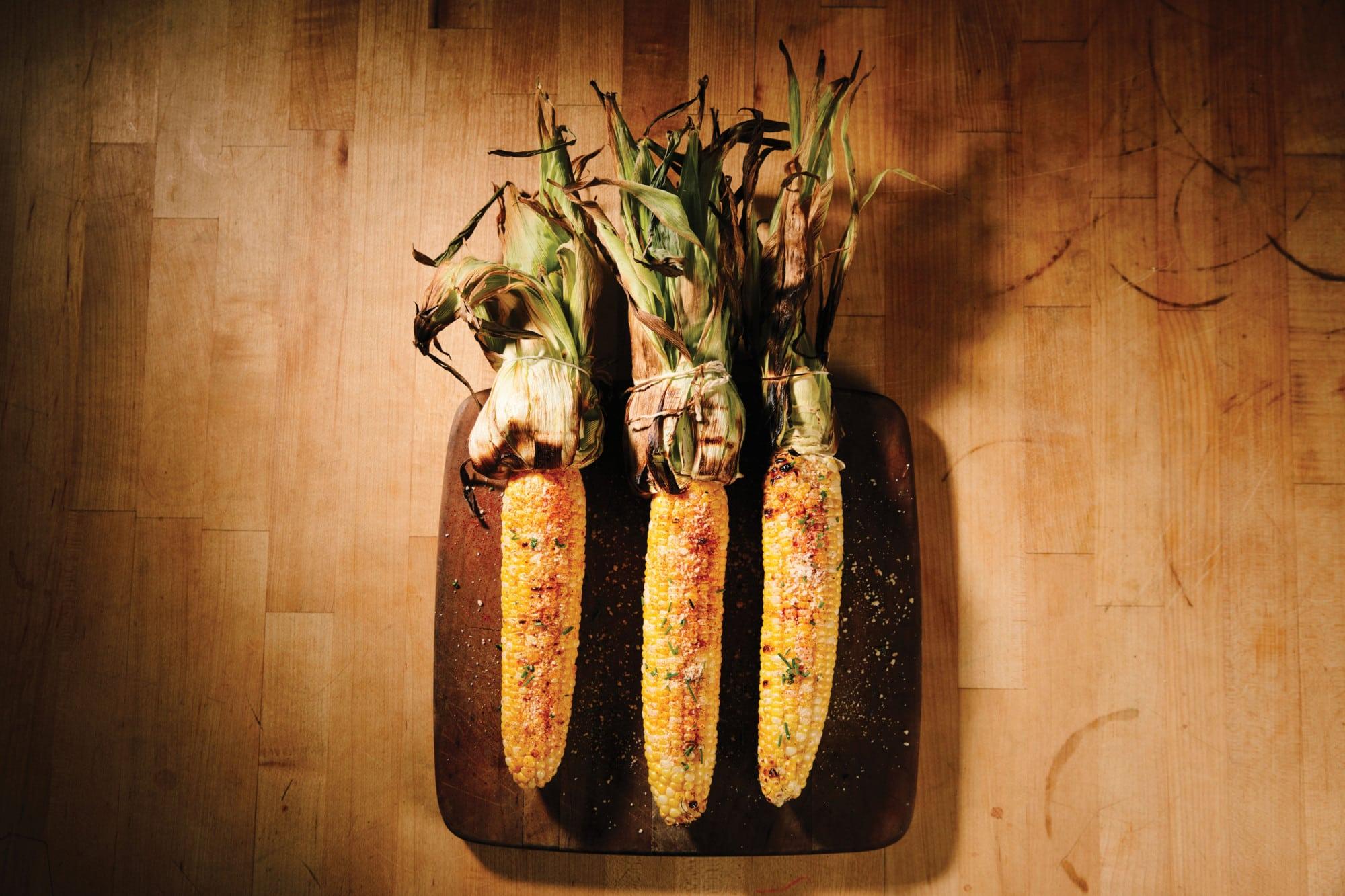 Three cobs of corn.